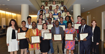 Photo of individuals who have earned SCL professional education certificates