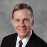 """Schneider National Chair in Transportation and Logistics and Professor Chelsea """"Chip"""" White"""