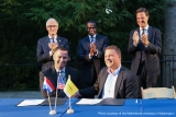 Flanked by Mr. Rutte of the Netherlands and Geert Bourgeois, minister-president of Flanders, left, Atlanta Mayor Kasim Reed looks on as Georgia Tech signs a new memorandum of understanding with European logistics institutes.