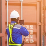 A Port of Savannah employee working with a shipping container