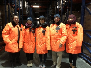 Jana Boerger and fellow doctoral students at Georgia Tech bundled up to visit Americold's cooling warehouses where they explored cold chain challenges with Americold's Vice President David Stuver.