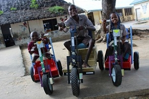 Patients in Kenya receive mobility carts donated by MedShare (Courtesy MedShare).